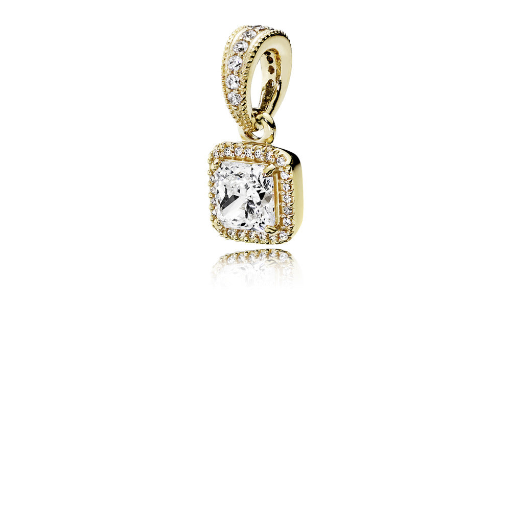 A gold dangle knot with cubic zirconia charm by Pandora.