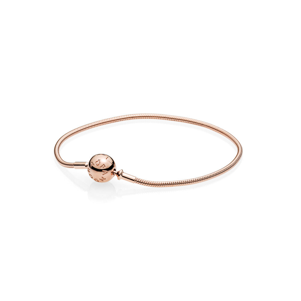 a rose gold charm bracelet by pandora.