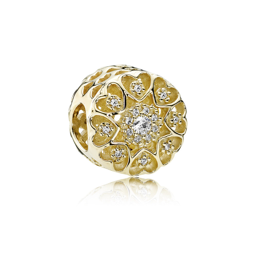 Hearts of Gold charm by Pandora Jewelry here in Santa Fe.