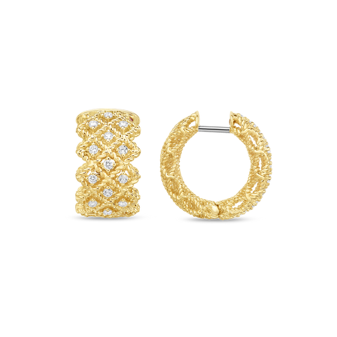 A 3 row set of diamond earrings made by Roberto Coin.
