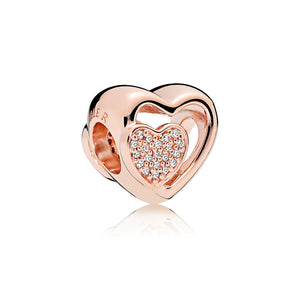 Heart charm in PANDORA Rose with clear cubic zirconia