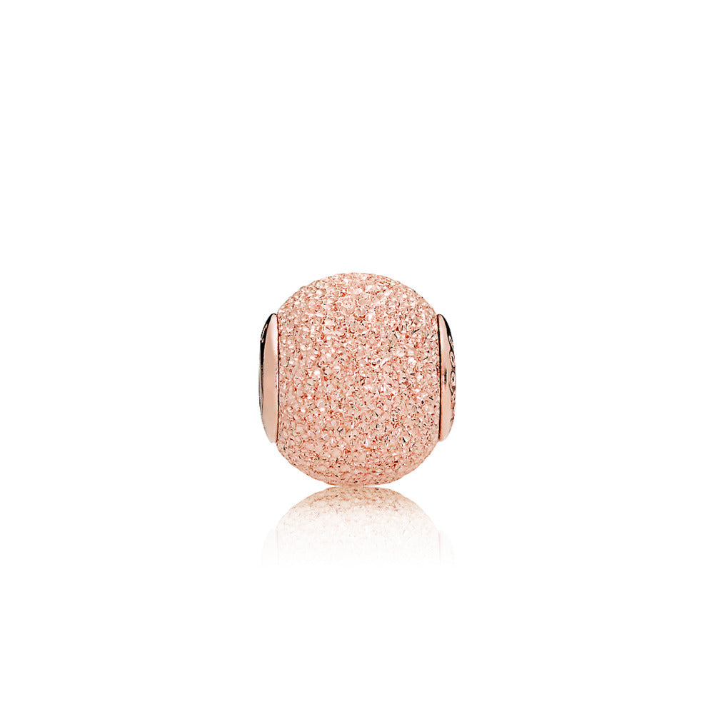 ESSENCE charm in PANDORA Rose with diamond-pointed texture