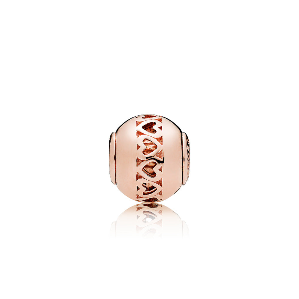ESSENCE charm in PANDORA Rose with cut-out heart details