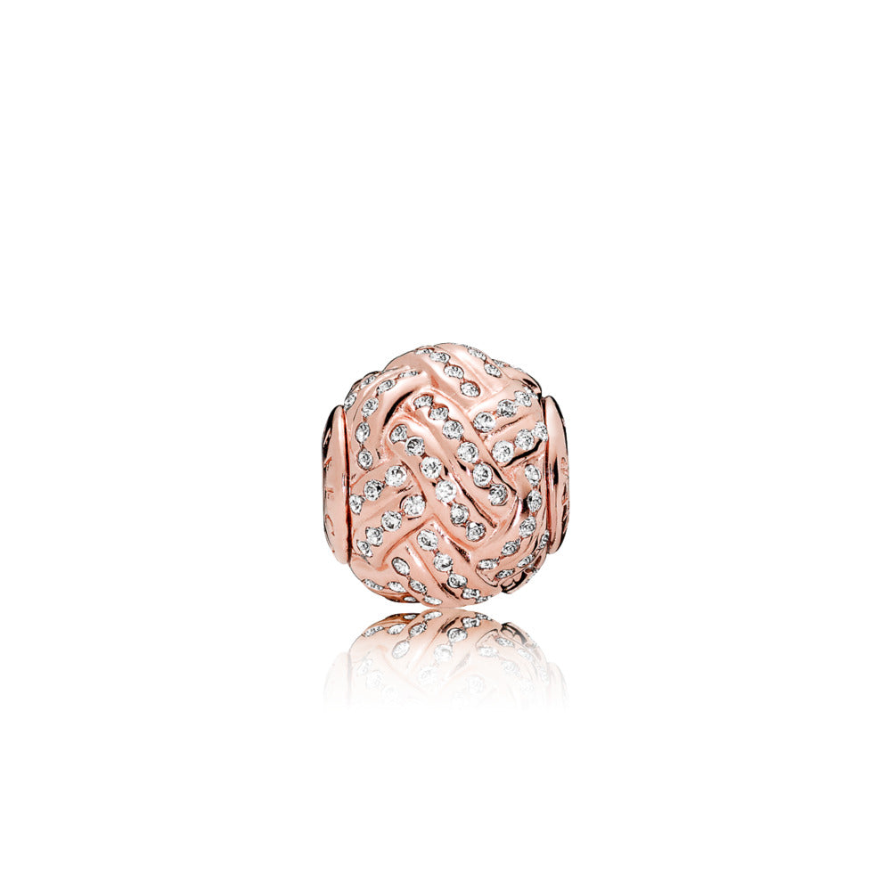 ESSENCE charm in PANDORA Rose with clear cubic zirconia in knot detail