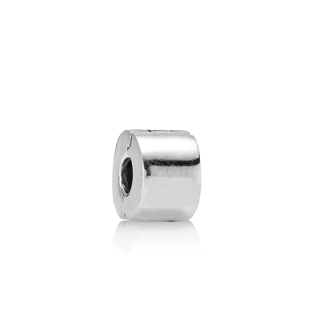 A plain silver spacer by Pandora.