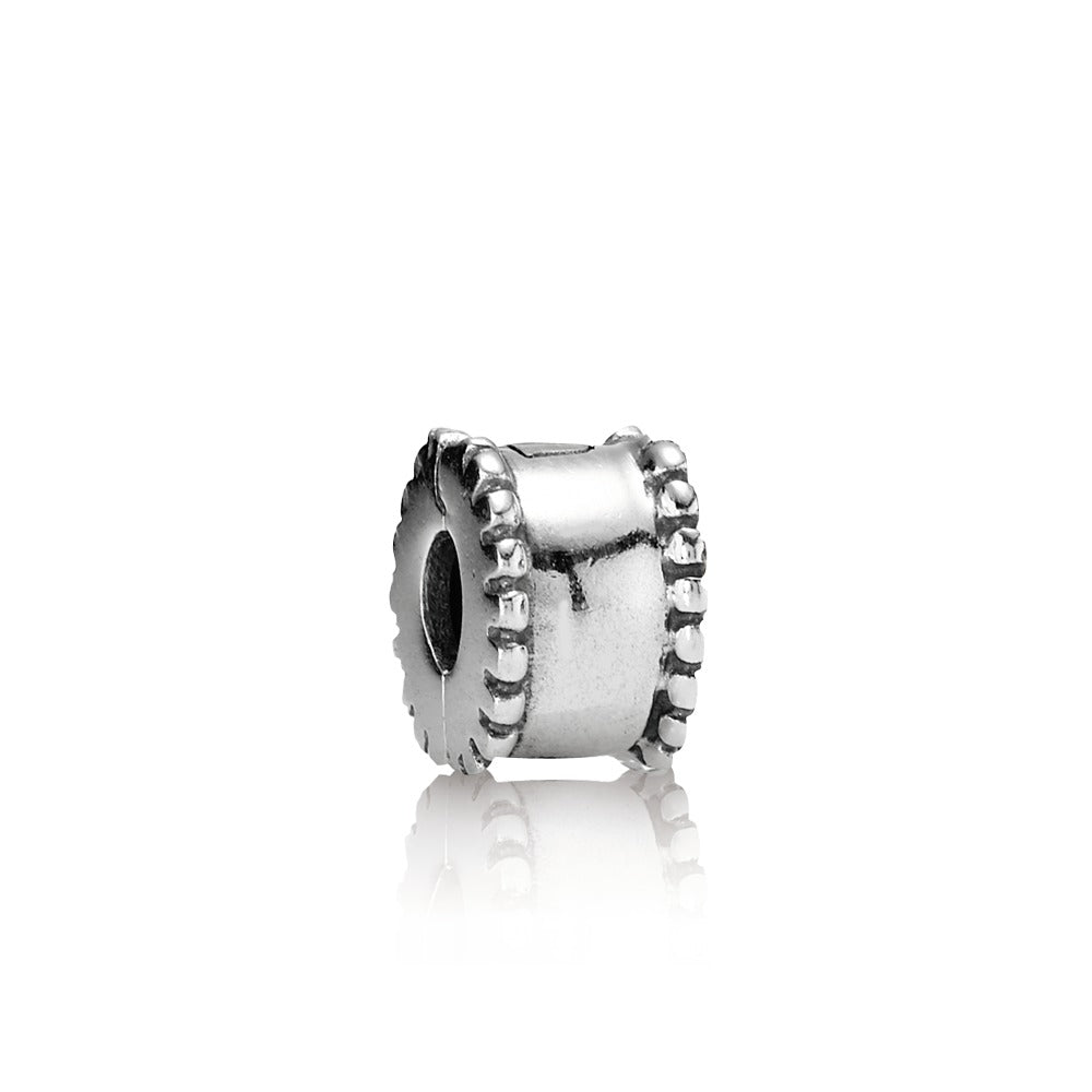 a beveled charm by Pandora.