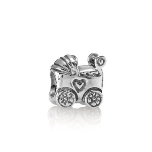A baby carriage charm by Pandora here in Santa Fe.