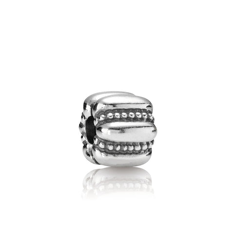 A charm titled crazy by Pandora.
