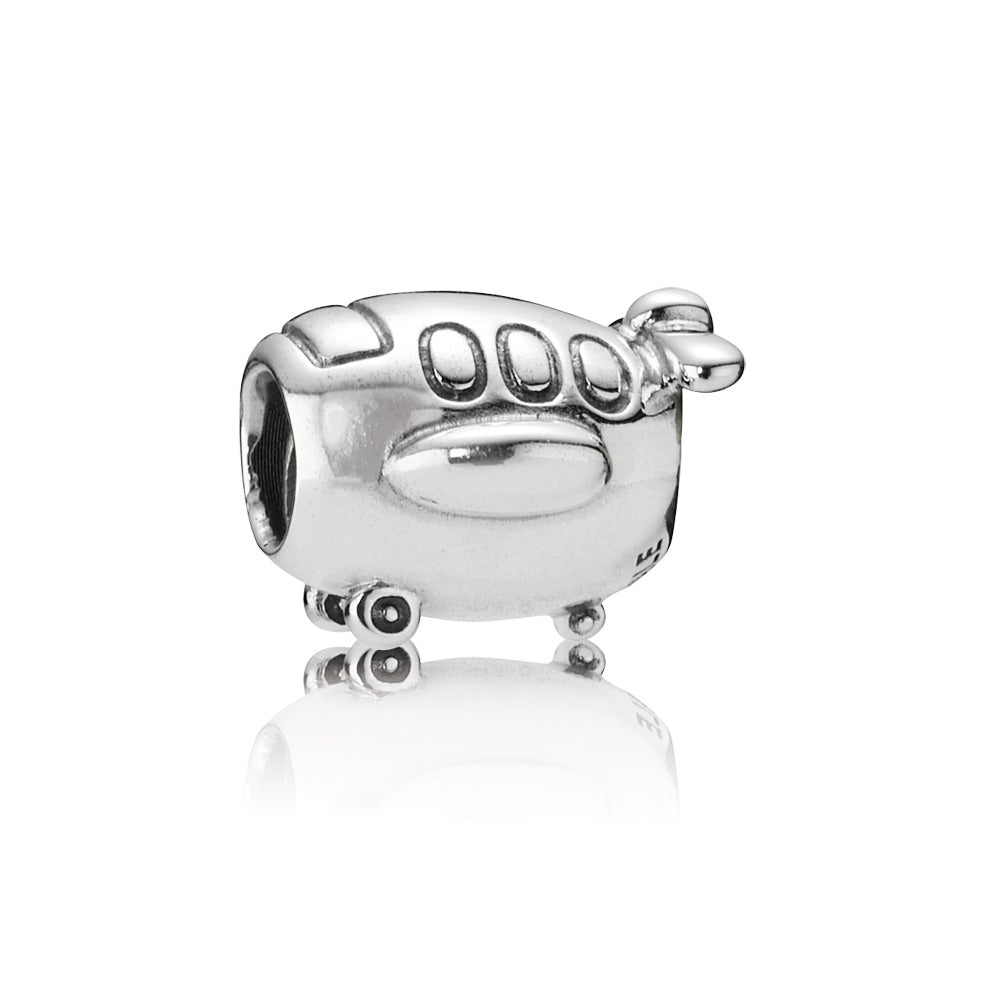 A silver airplane charm by Pandora here in Santa Fe.