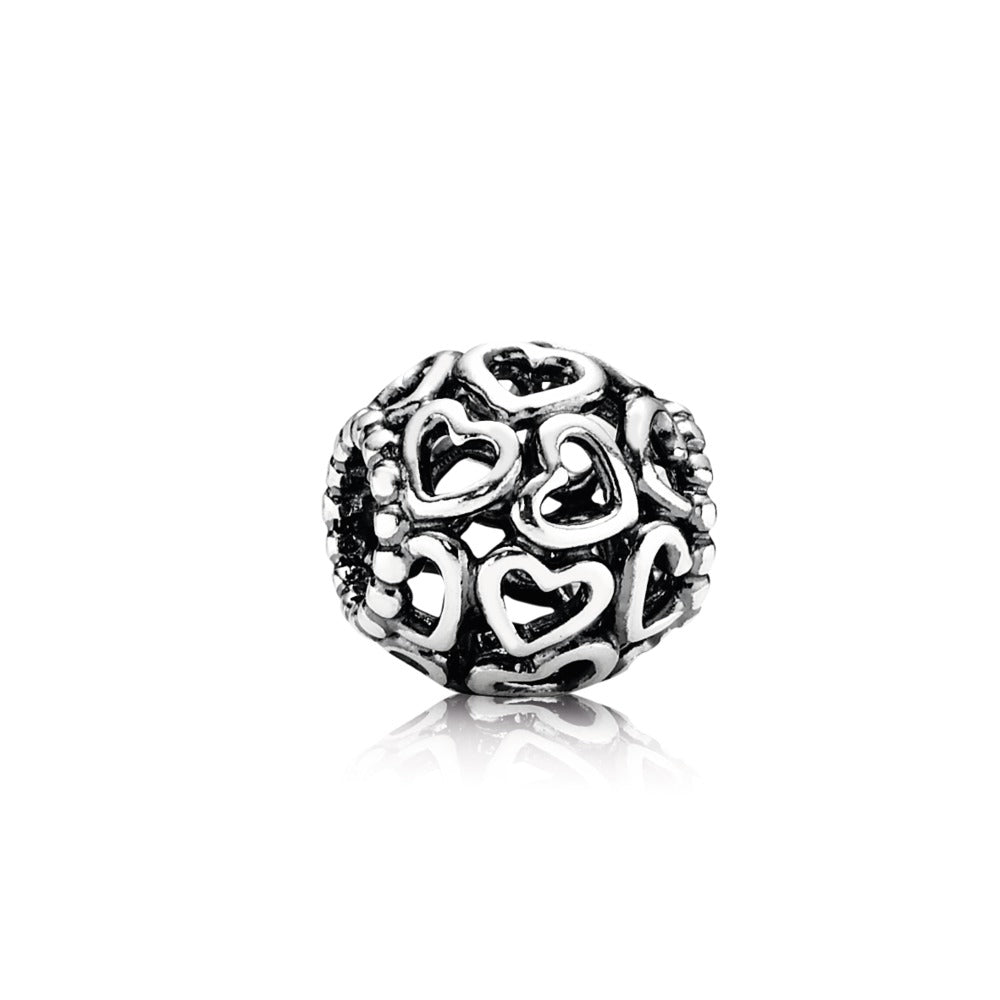 A open heart pendant in silver by Pandora.