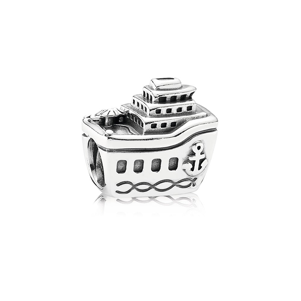 A silver charm of a boat by Pandora here in Santa Fe.