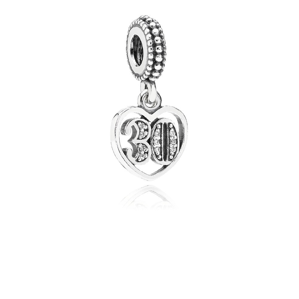 Silver Pandora Charm in the shape of a heart with a 30 in the middle here in Santa Fe