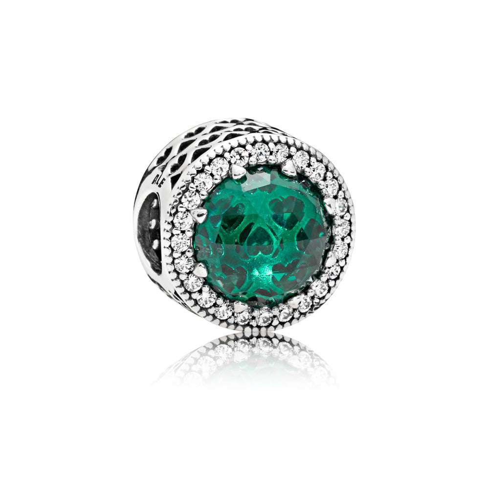 A green glass bead charm by Pandora here in Santa Fe.