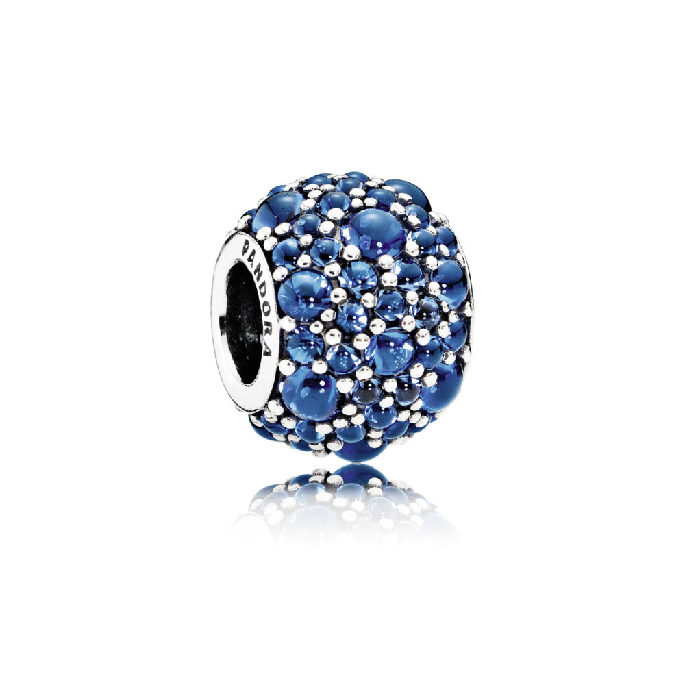 A purple shimmering droplet charm by Pandora.