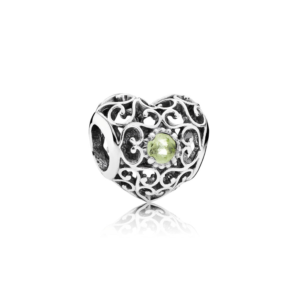 A silver pandora heart charm with a gemstone center here in Santa Fe.