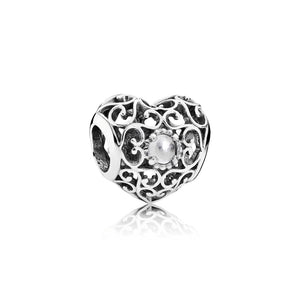 April Signature Heart charm by Pandora, rock crystal.