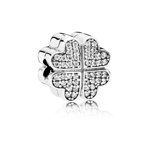 A flower petal charm with cubic zirconia by Pandora.