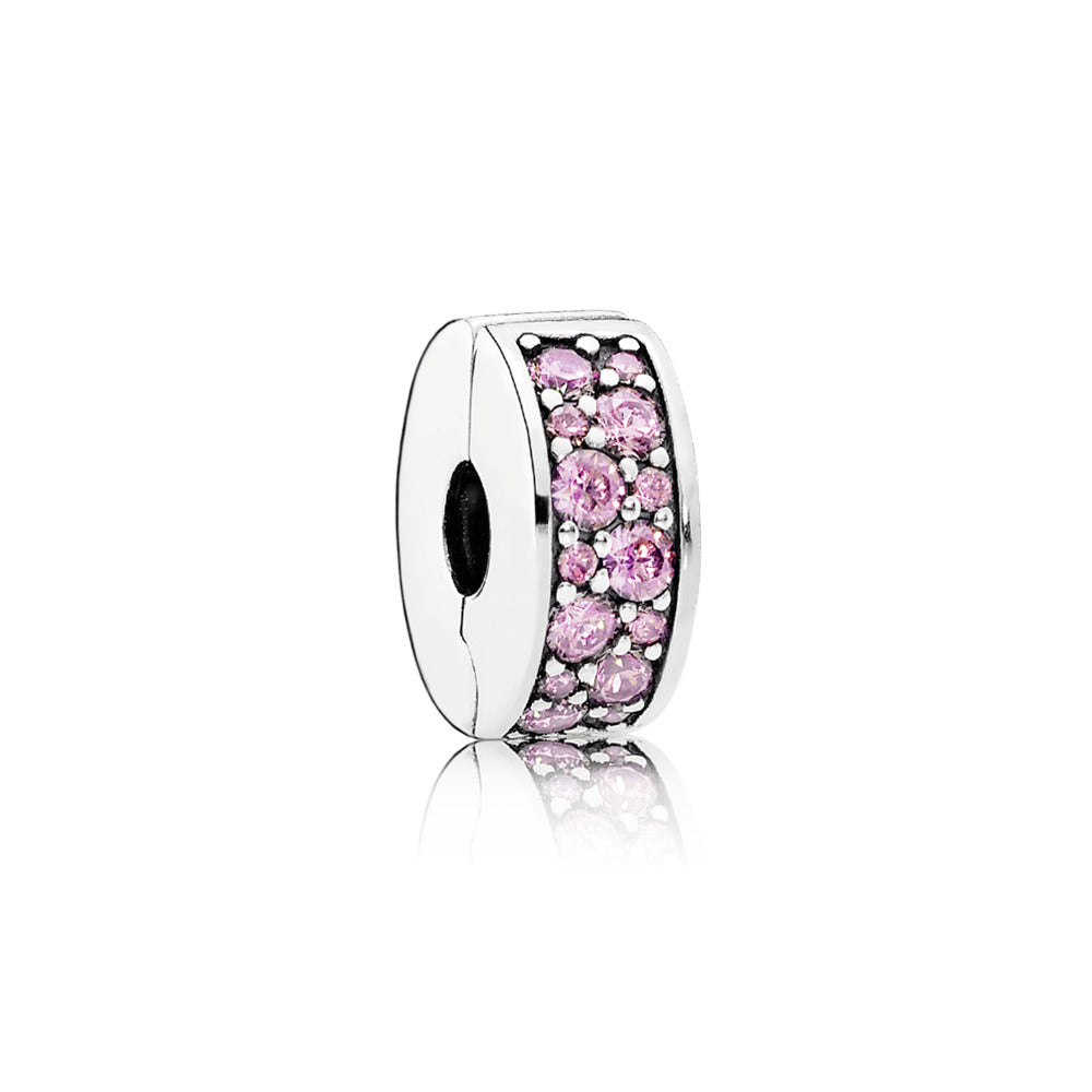 A pandora charm with pink cubic zirconia.