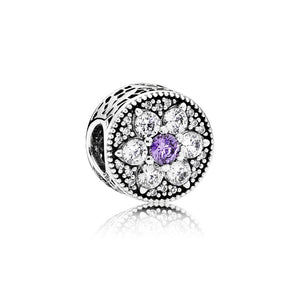 A forget me not charm with purple by Pandora.