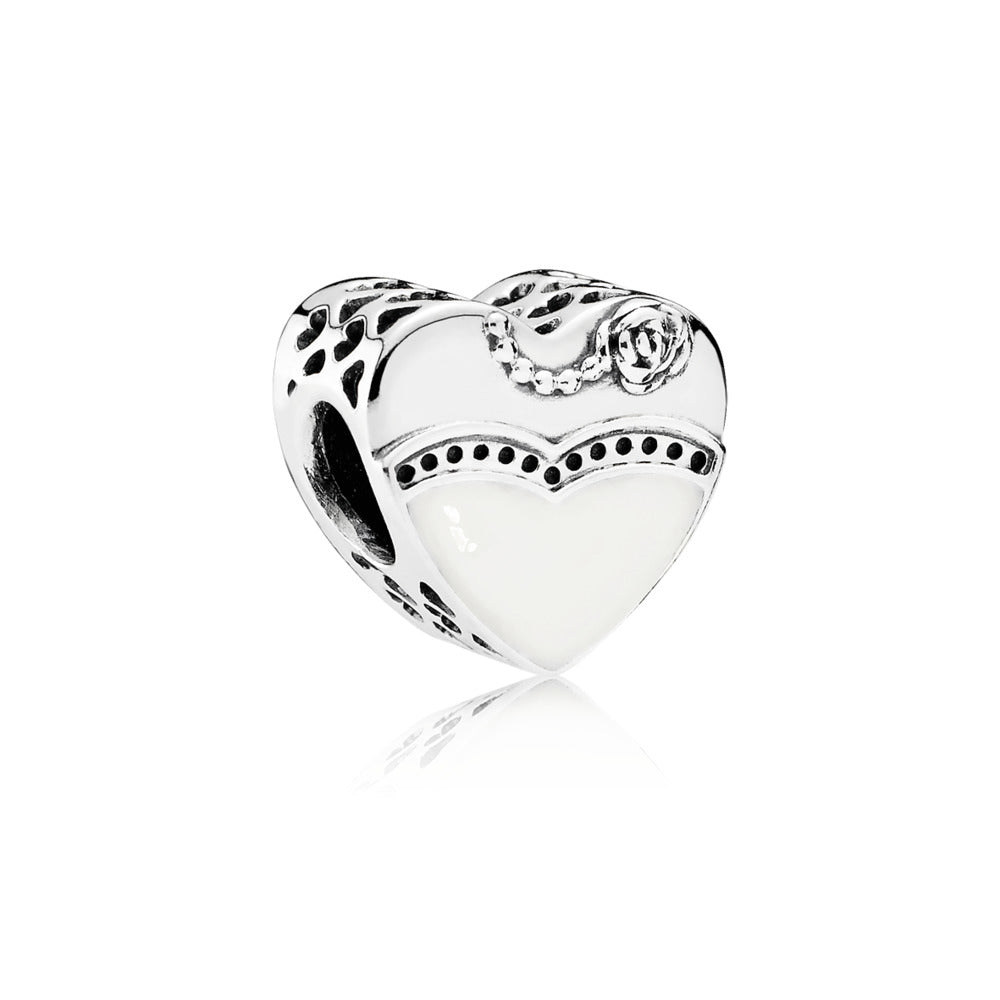 A heart charm with a line through the middle by Pandora.