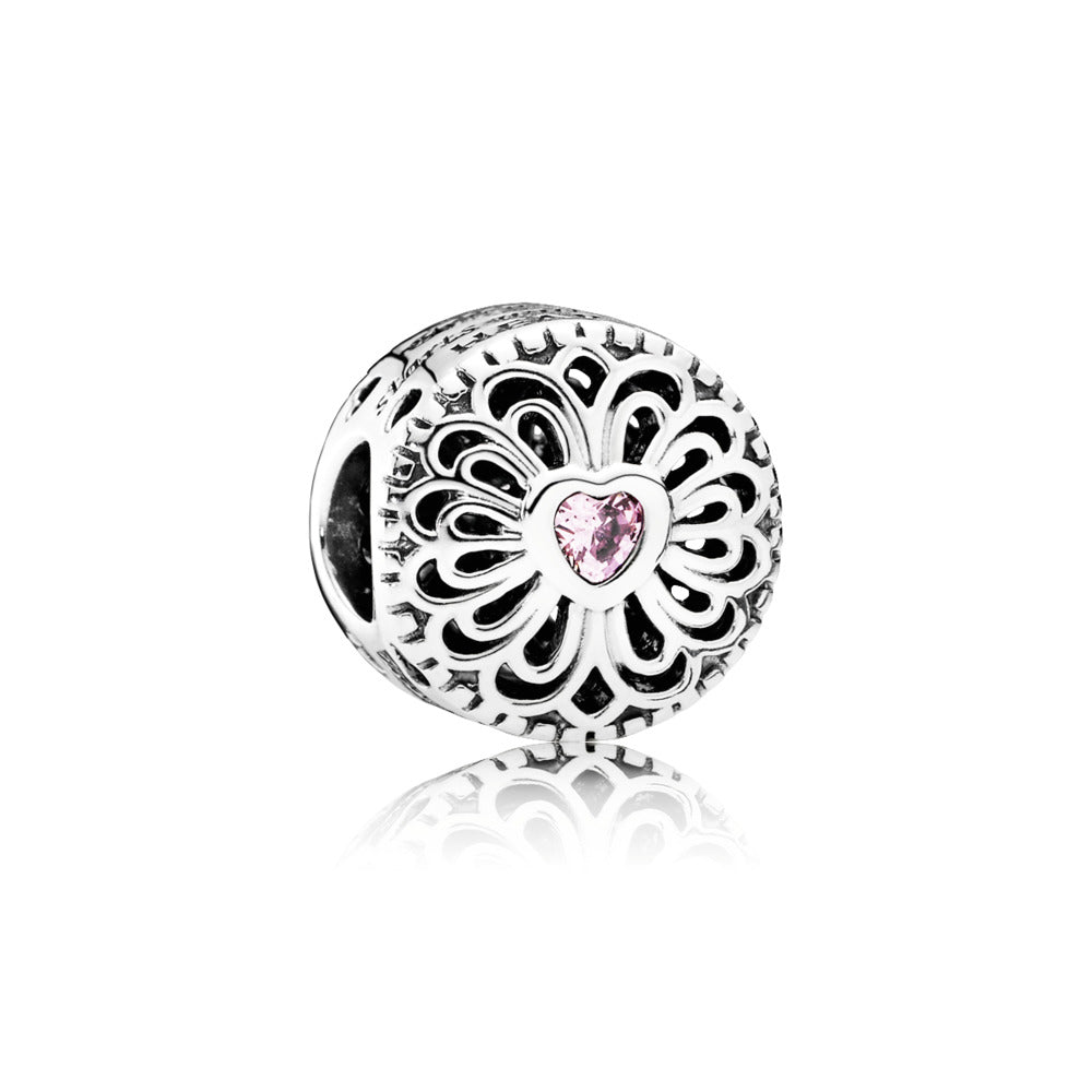 love and friendship charm with a heart in the middle of a flower by Pandora.