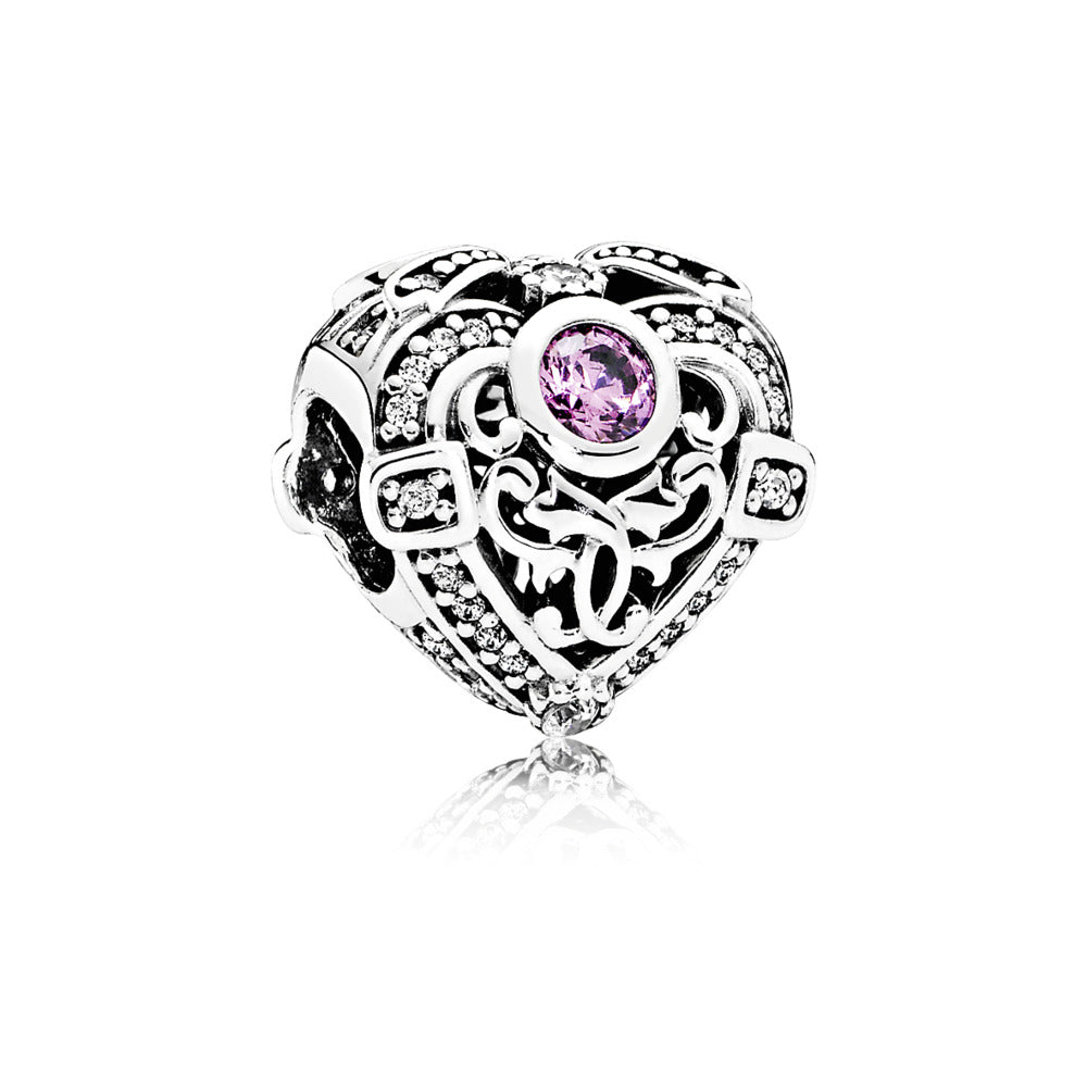 A heart charm with a pink stone in the top by Pandora.