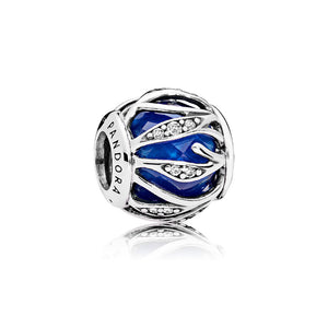A royal blue enamel charm by Pandora.