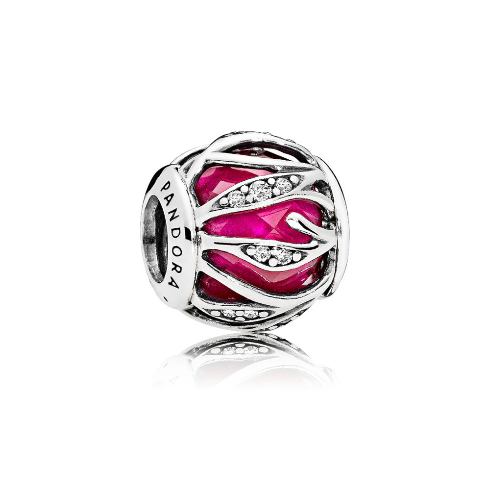 Charm in sterling silver with encased faceted synthetic ruby and clear cubic zirconia