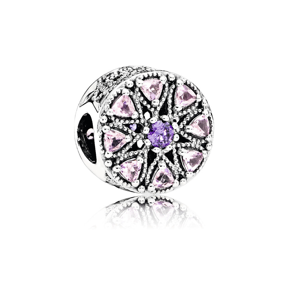A shimmering medallion with purple rose pink charm by Pandora.