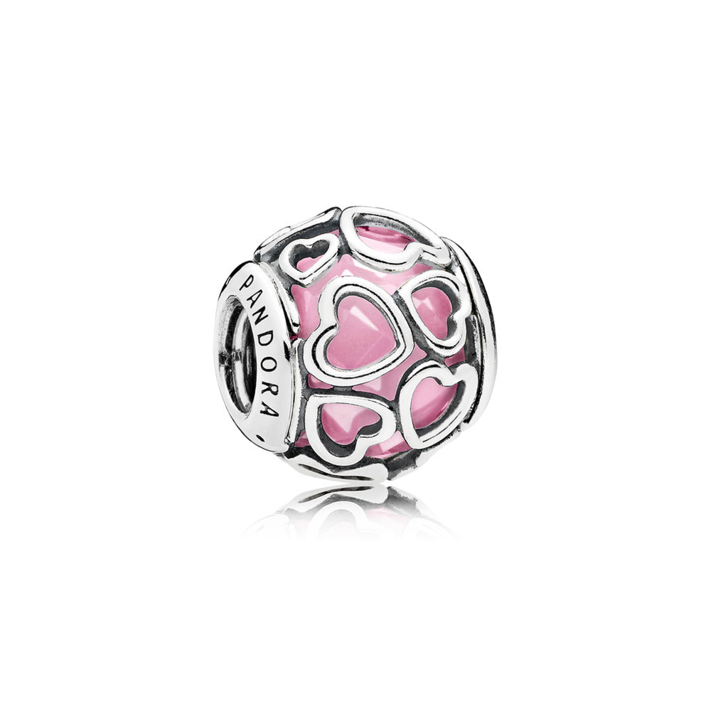 Heart charm in sterling silver with encased faceted pink cubic zirconia