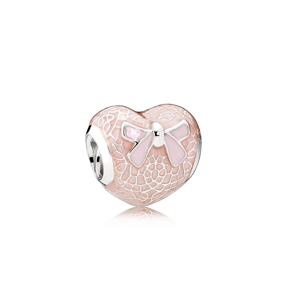 A pink bow and lace charm by Pandora.