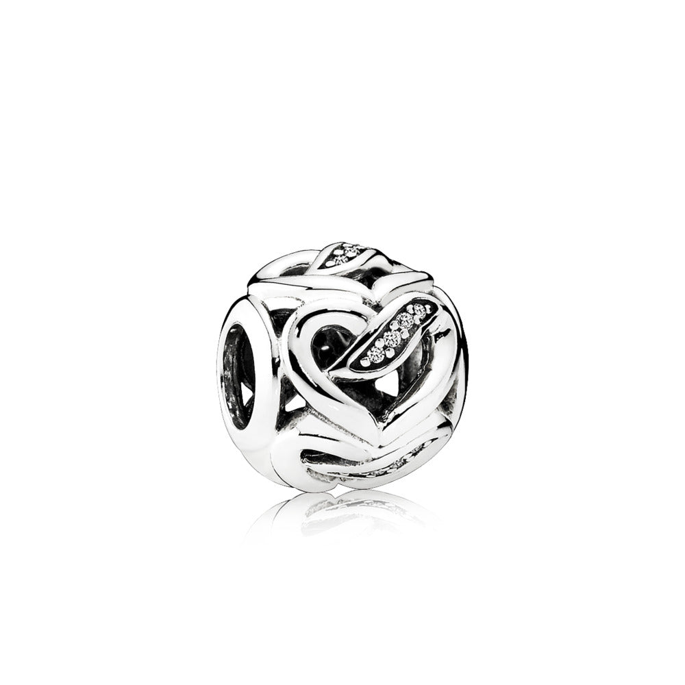 Charm with feather and heart in the middle by Pandora
