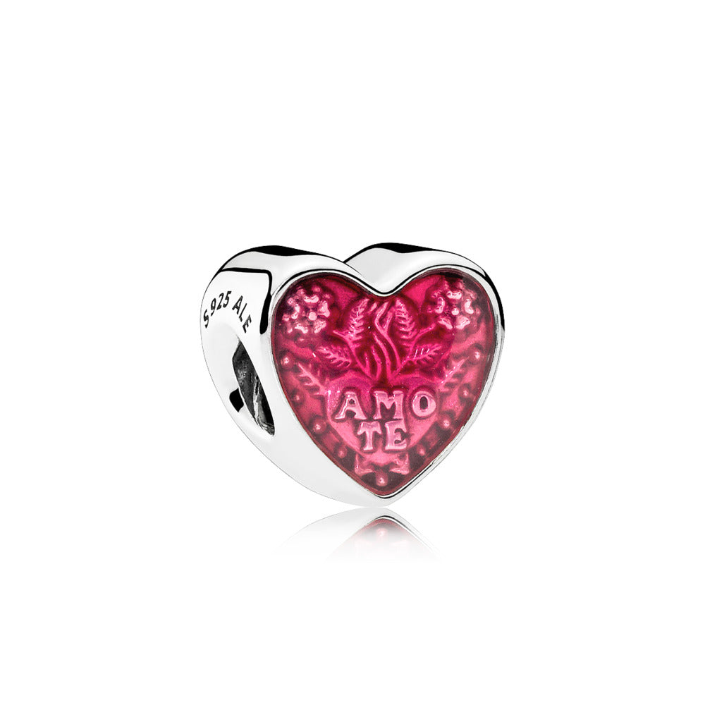 A red enamel heart charm
