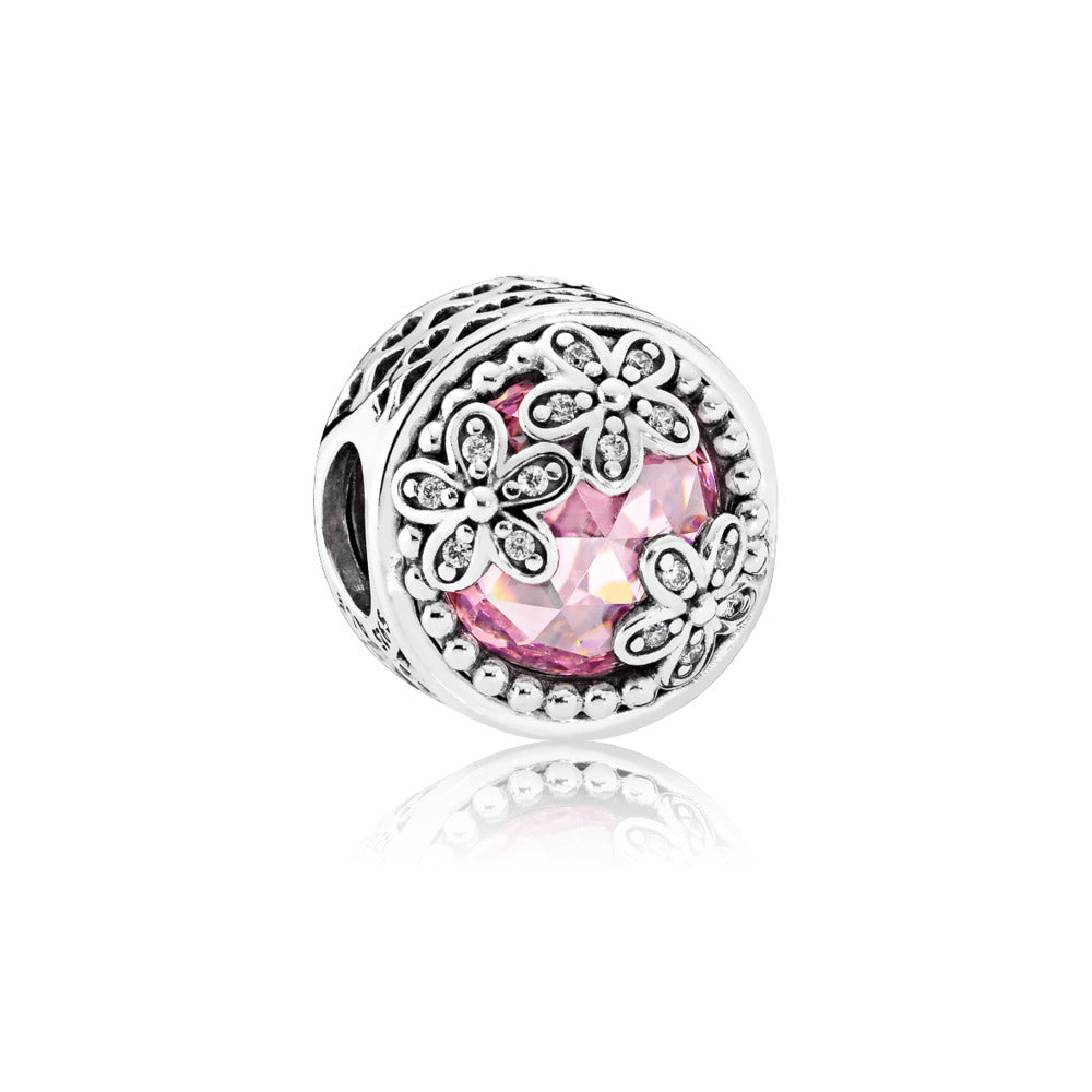 A dazzling daisy pink cubic zirconia charm by Pandora.