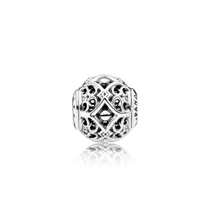 A silver bead charm with intricate design by Pandora here in Santa Fe.