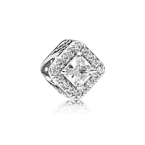 A charm in sterling silver with clear cubic zirconia by Pandora.