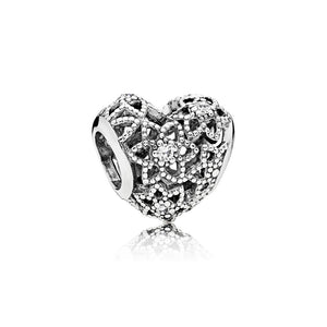 Openwork heart charm in sterling silver by Pandora.