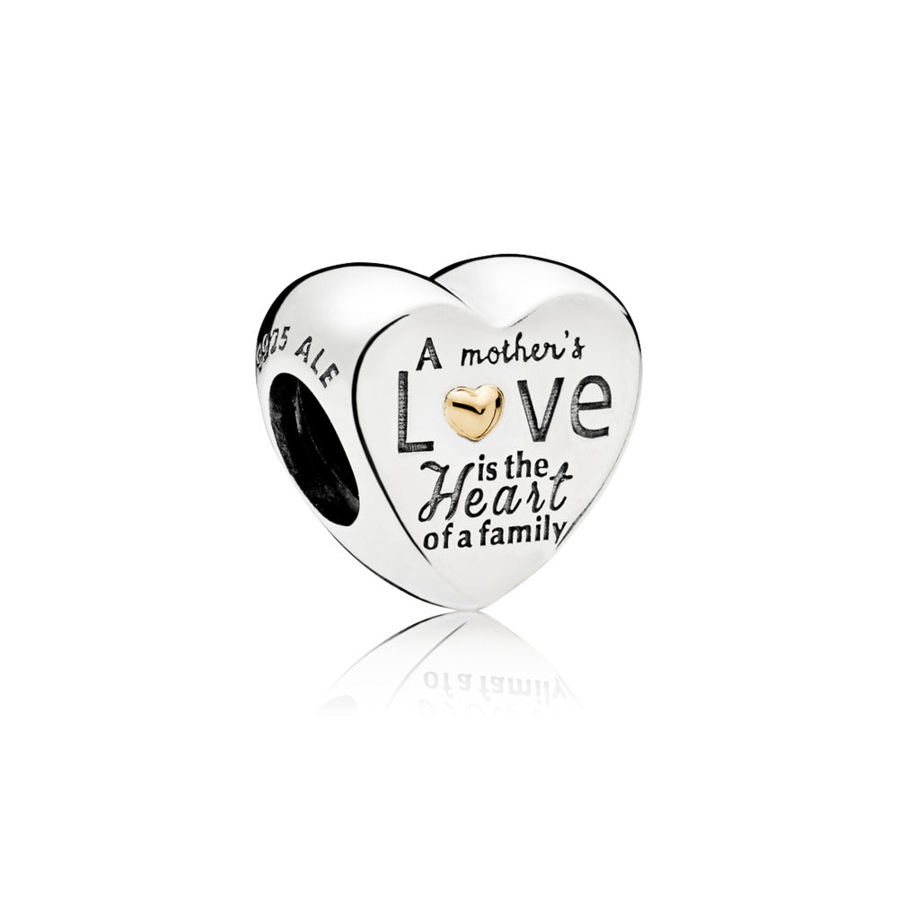 "Charm in sterling silver with 14k gold and engraving ""A mother's love is the heart of a family"""