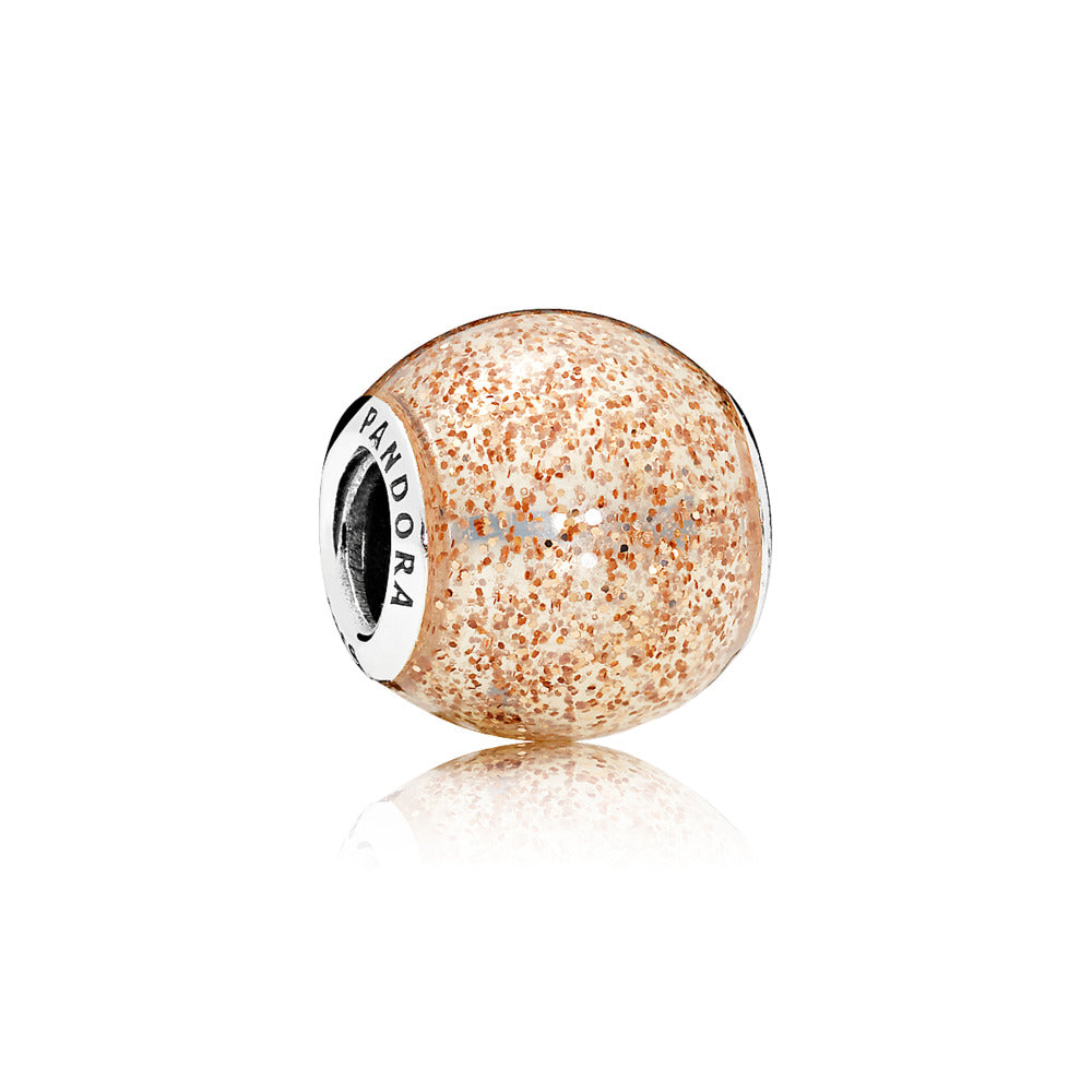 A rose gold enamel charm by Pandora