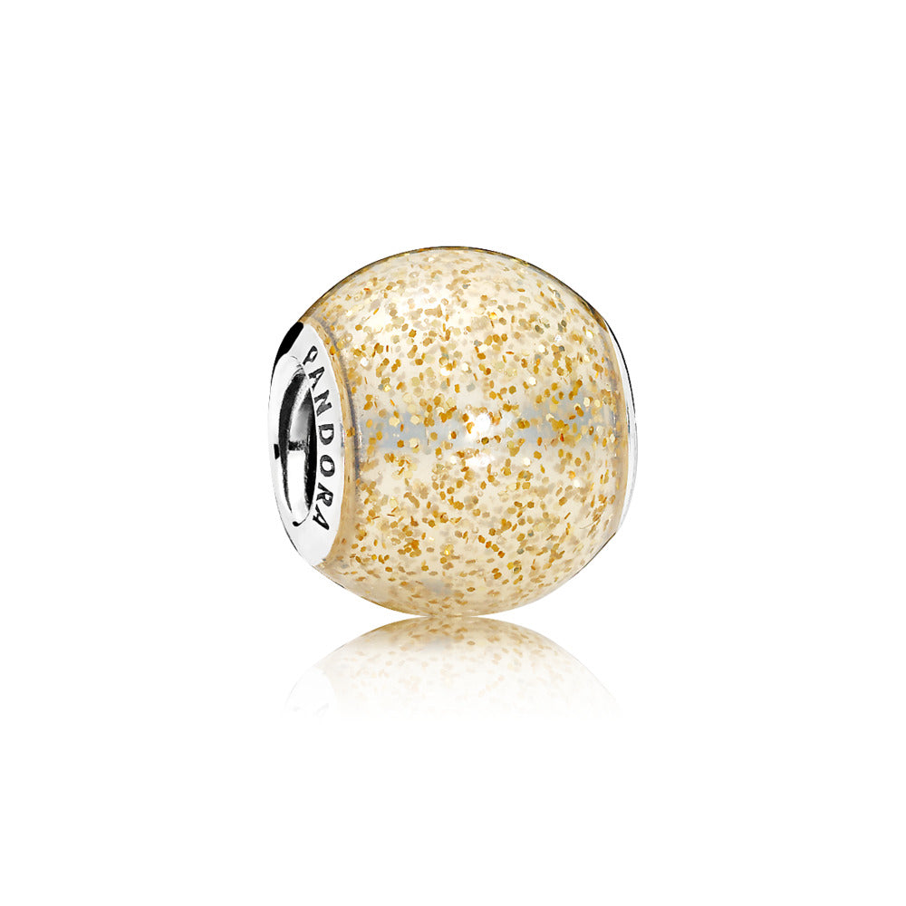 A sterling silver charm with transparent golden glitter enamel by Pandora.