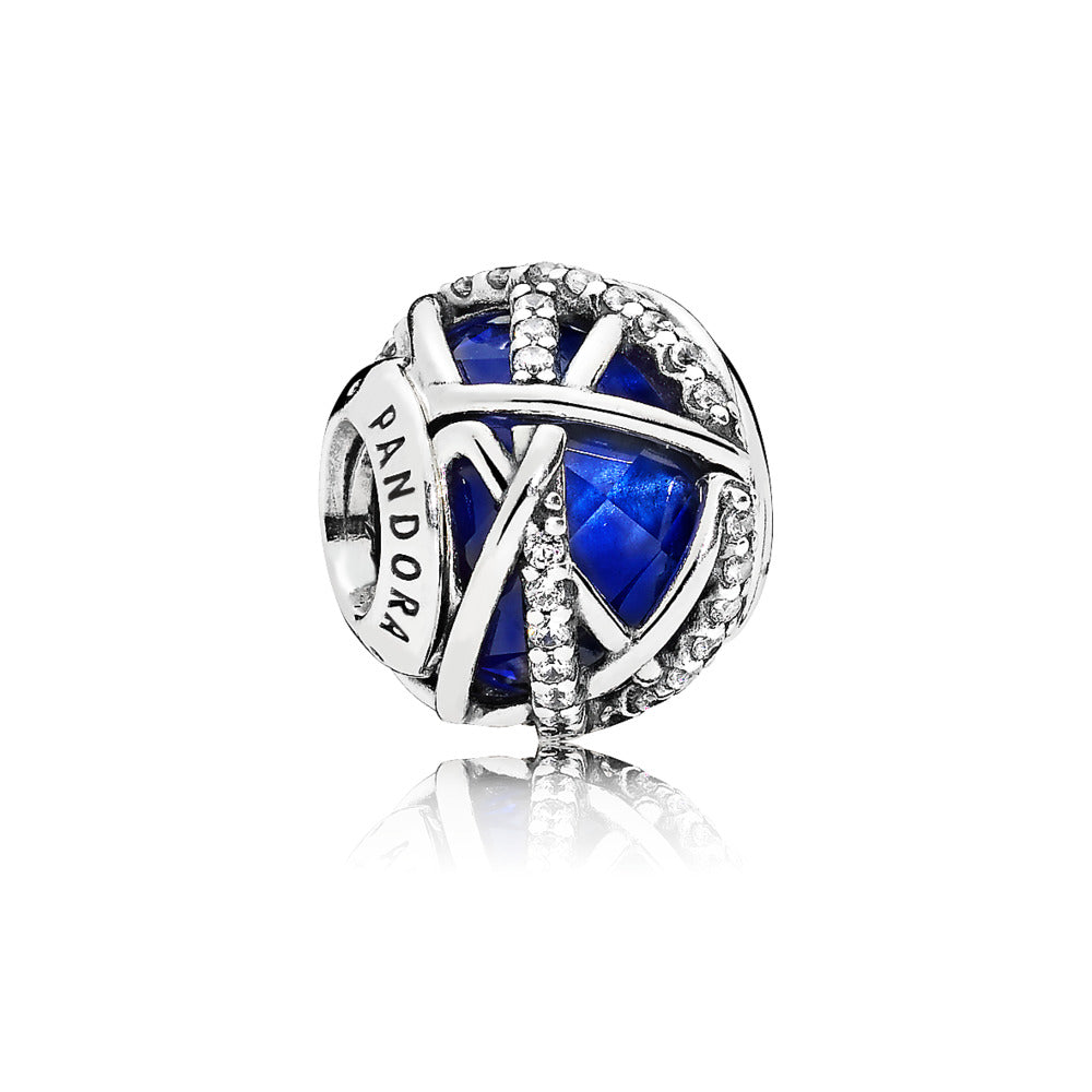 A circle faceted blue enamel charm by Pandora.