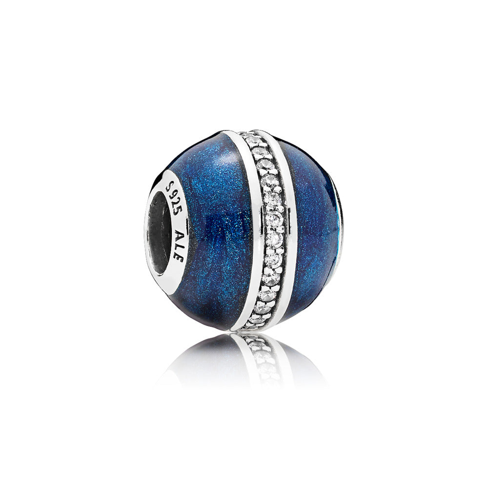 Charm in sterling silver with clear cubic zirconia and shimmering midnight blue enamel