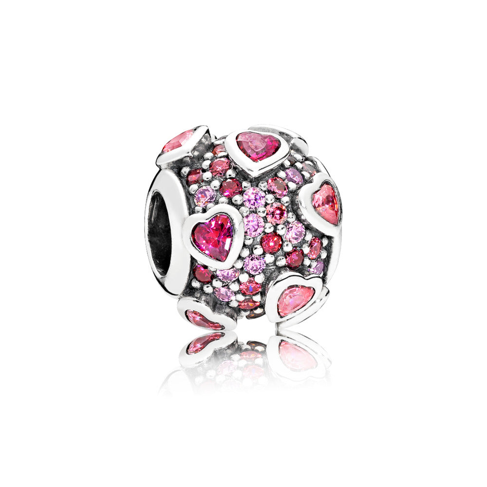 Silver charm with fancy pink, red and orchid cubic zirconia