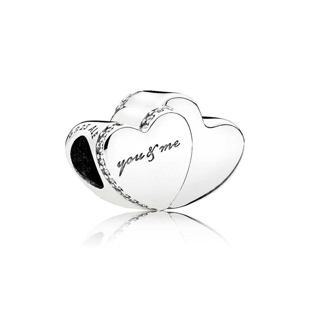 Double heart silver charm with clear cubic zirconia