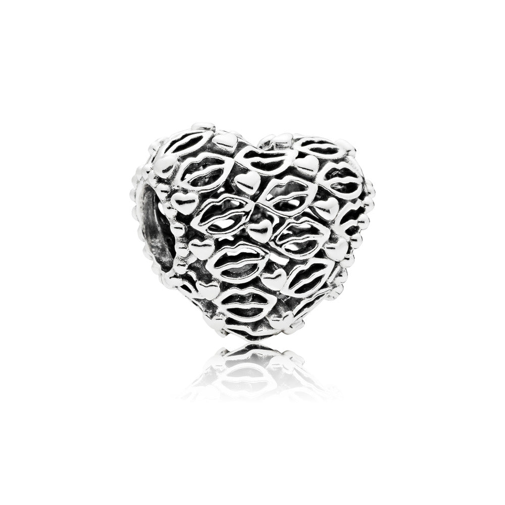 Heart charm in sterling silver with lip and heart details