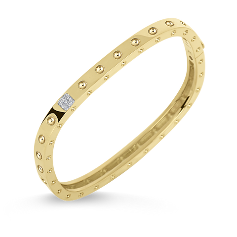 A yellow gold bangle with a single row of diamonds from Roberto Coin's Santa Fe Jewelry