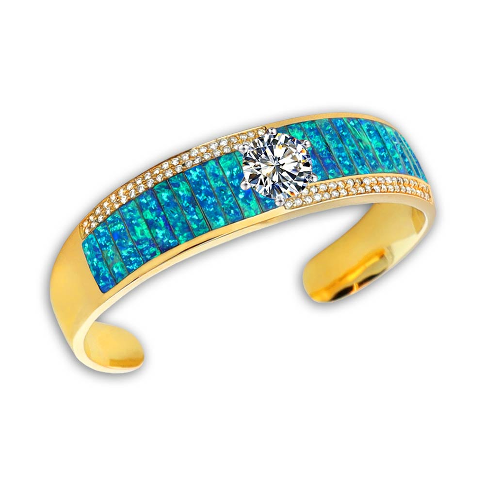 A Turquoise and Diamond gold bangle by Gold House Santa Fe.