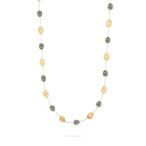 A mother of pearl necklace in white and black by Marco Bicego Santa Fe Jewelry.