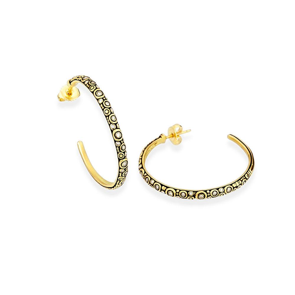 A pair of hoop earrings made by Alex Sepkus Santa Fe Jewelry