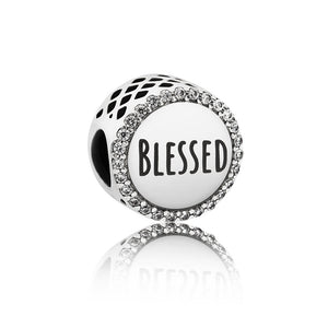 A charm with the word Blessed on it by Pandora.